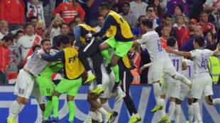 Al Ain players celebrate a goal.