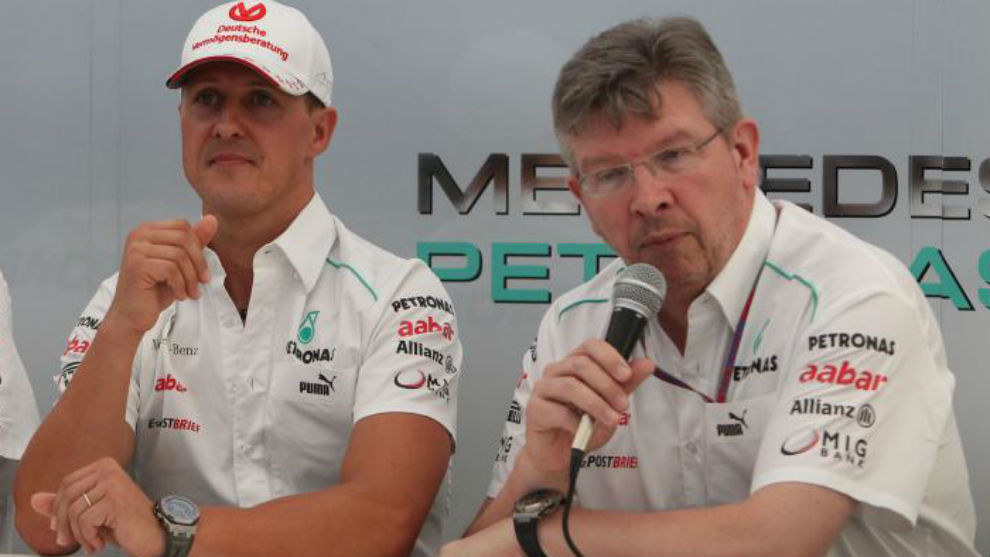 Schumacher y Brawn, durante el Gran Premio de Japón 2012.