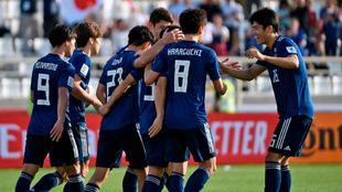 Los japoneses, celebrando un gol durante el partido