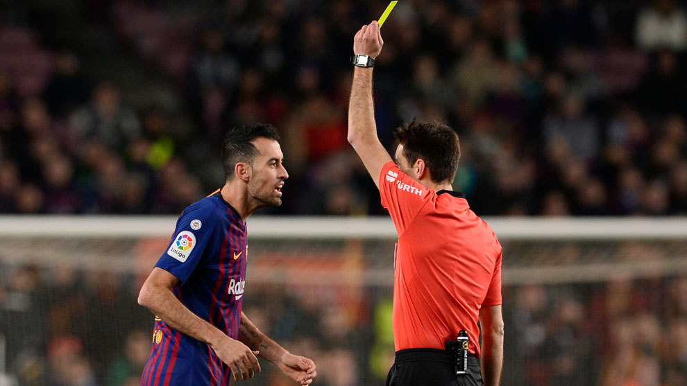 Busquets receives a yellow card.