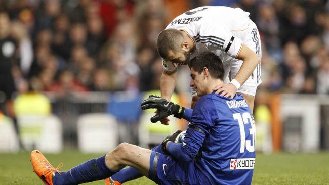 Benzema y Courtois, en el derbi de Copa de 2014