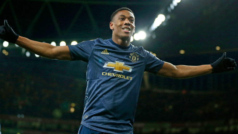 Martial celebrates his goal in front of his fans