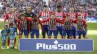 Los jugadores del Atlético posan en la foto oficial.
