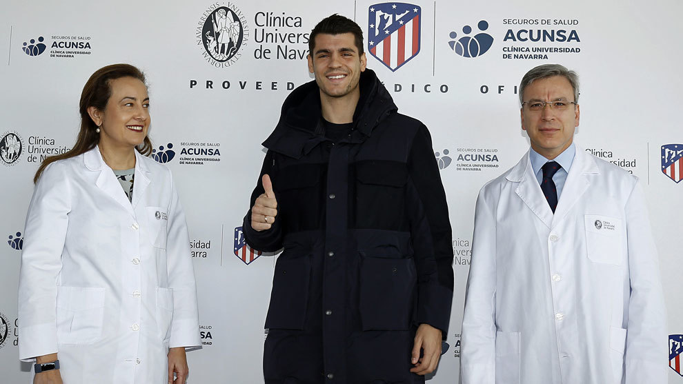 Morata poses after passing his medical examinations.