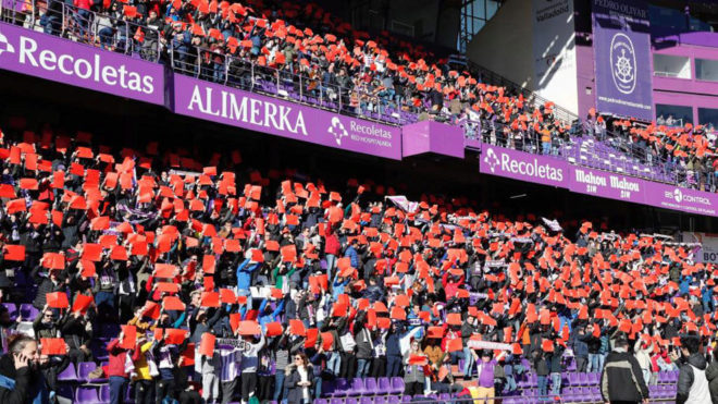 The Valladolid supporters showing the red card to those in the VAR...
