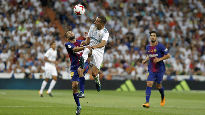 Lucas Vázquez fighting for the ball with Jordi Alba during a Clasico...