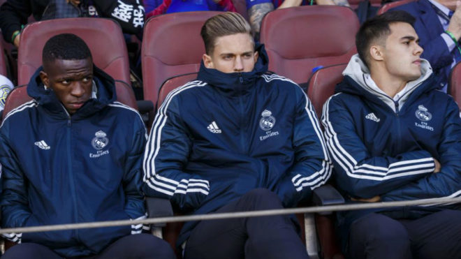 Vinícius, Llorente and Reguilón in the stands during the last...