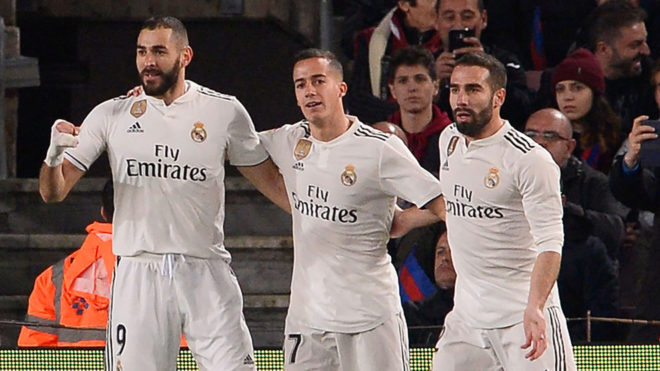 Benzema, Lucas and Carvajal celebrating Madrid making it 0-1.