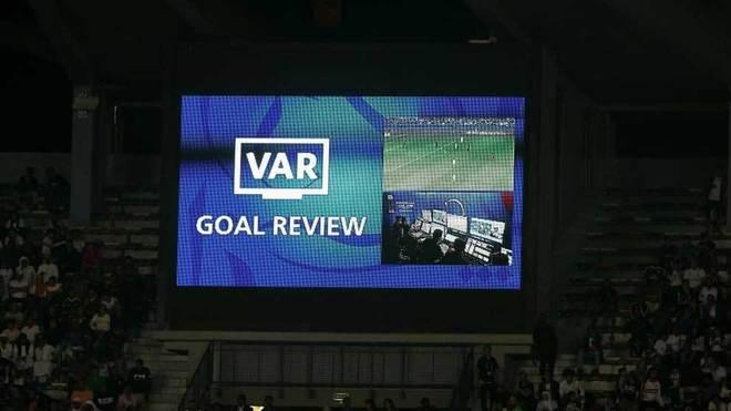 An image inside a stadium of VAR reviewing a goal.