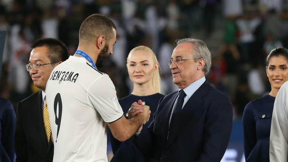 Benzema greeting Perez after winning the Club World Cup in December.
