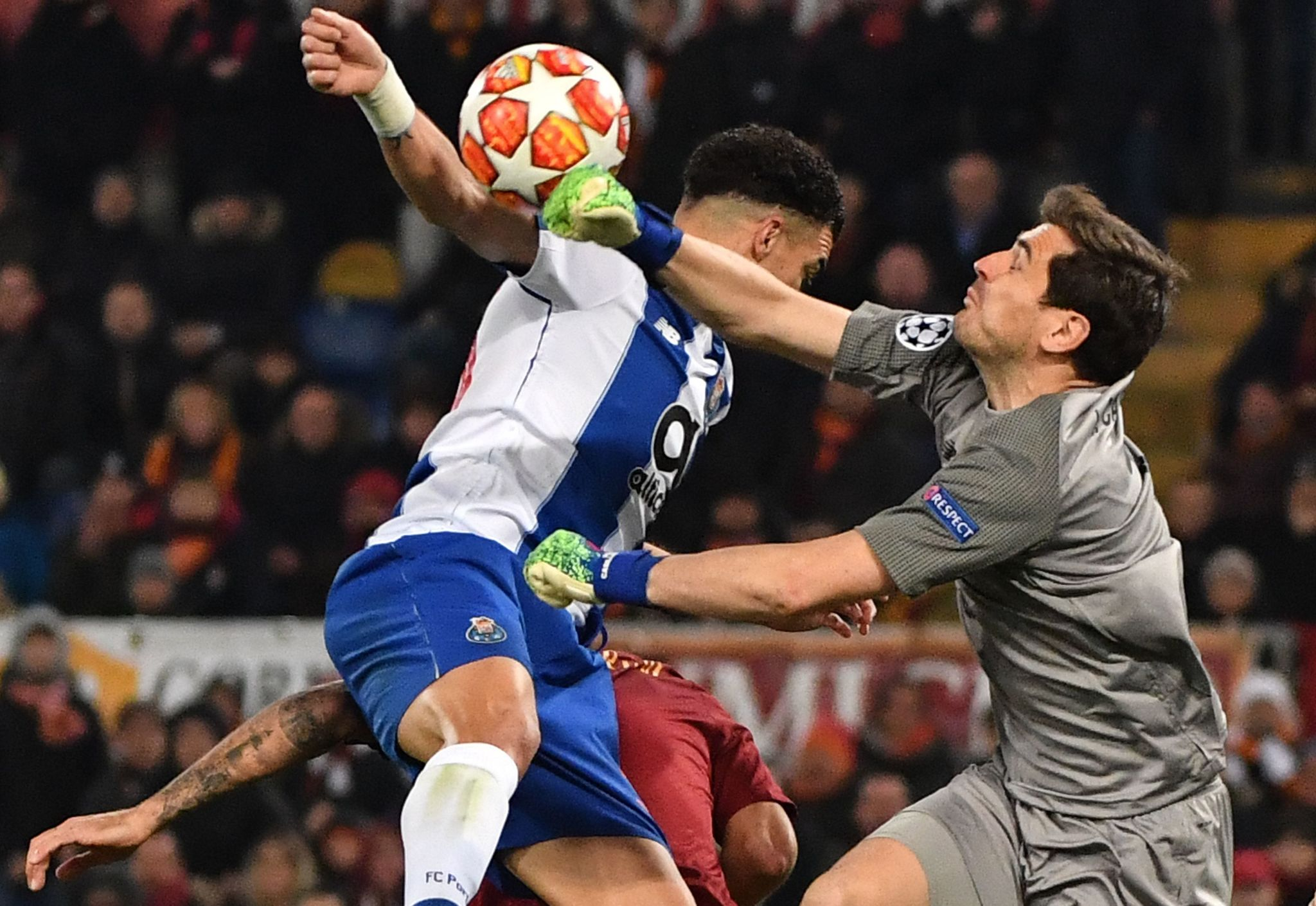 Portos Spanish goalkeeper Iker Casillas (R) defelcts a shot as Portos Brazilian defender Pepe (C) goes for a header during the UEFA Champions League round of 16, first leg football match AS Roma vs FC Porto on February 12, 2019 at the Olympic stadium in Rome. (Photo by Andreas SOLARO / AFP)