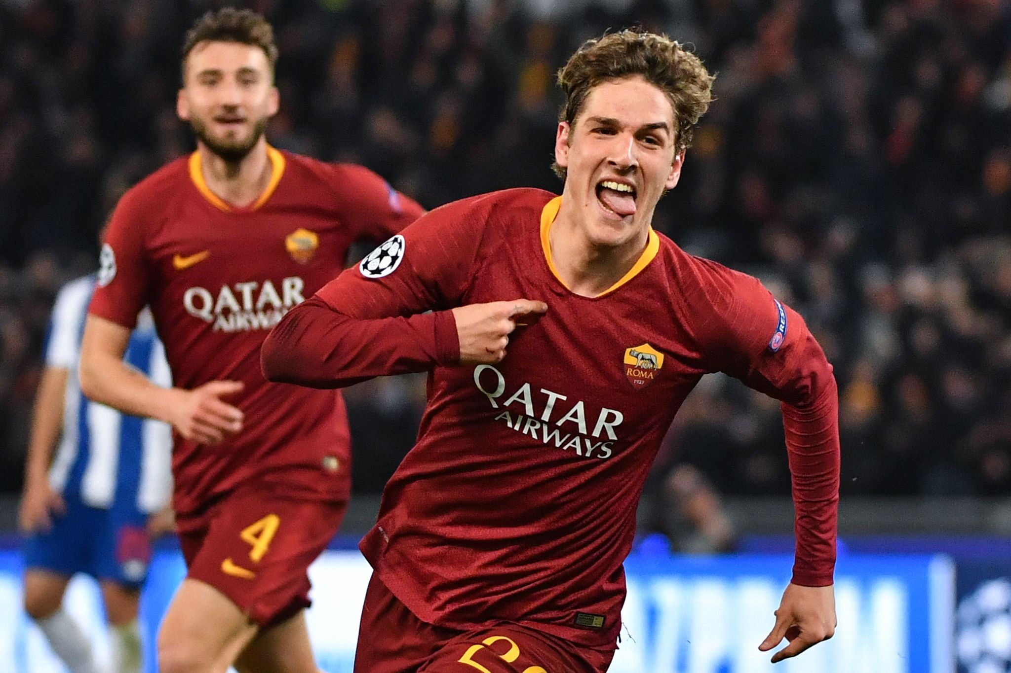 AS Roma Italian midfielder Nicolo Zaniolo celebrates after opening the scoring during the UEFA Champions League round of 16, first leg football match AS Roma vs FC Porto on February 12, 2019 at the Olympic stadium in Rome. (Photo by Andreas SOLARO / AFP)