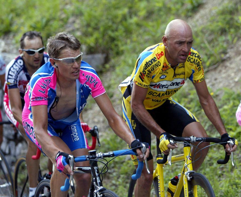 (FILES) This file photo taken on May 22, 2003 shows Lithuanian Raimondas Rumsas (L) and Italian Marco <HIT>Pantani</HIT> climbing Monte Zoncolan, during the 12th stage of the Giro dItalia. Italys supreme court has ruled definitively that former cycling star Marco <HIT>Pantani</HIT> was not murdered, Italian media reported on September 28, 2017. The investigation into the death of <HIT>Pantani</HIT>, on February 14, 2004 in a hotel in Rimini, had been reopened in 2014 at the request of his family who suspected foul play. But a court in Rimini in June 2016 concluded there was no evidence to indicate the 34-year-old was murdered. / AFP PHOTO / FRANCK FIFE
