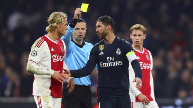 Ramos receiving the yellow card in Amsterdam.