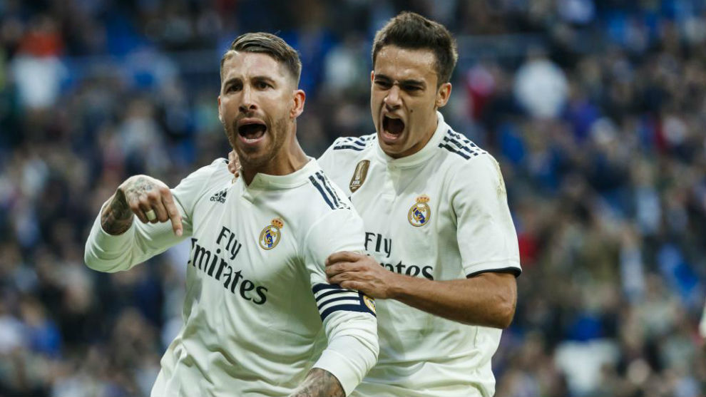 Reguilón celebrates with Sergio Ramos after the captain scored a...