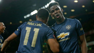 Pogba and Martial celebrate a goal for Manchester United.