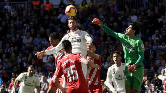 Ramos attempts a header.