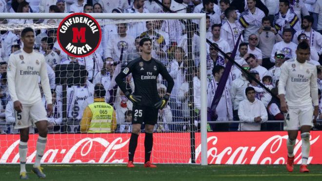 Courtois, Varane y Casemiro, tras encajar el segundo gol del Girona.