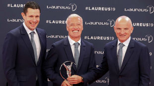 Didier Deschamps receives the award on behalf of the French World Cup...