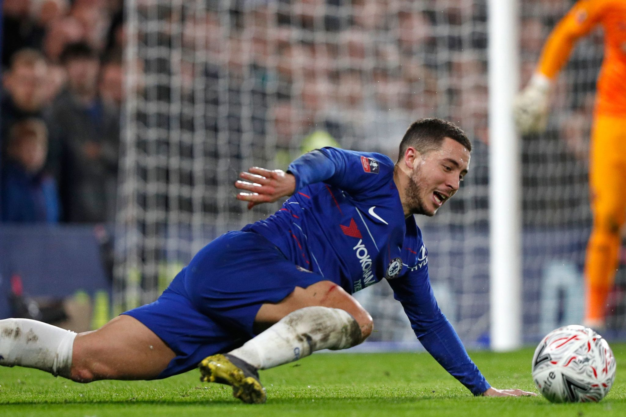 <HIT>Chelsea</HIT>s Belgian midfielder Eden Hazard falls to the ground during the English FA Cup fifth round football match between <HIT>Chelsea</HIT> and Manchester United at Stamford Bridge in London on February 18, 2019. (Photo by Adrian DENNIS / AFP) / RESTRICTED TO EDITORIAL USE. No use with unauthorized audio, video, data, fixture lists, club/league logos or live services. Online in-match use limited to 120 images. An additional 40 images may be used in extra time. No video emulation. Social media in-match use limited to 120 images. An additional 40 images may be used in extra time. No use in betting publications, games or single club/league/player publications. /