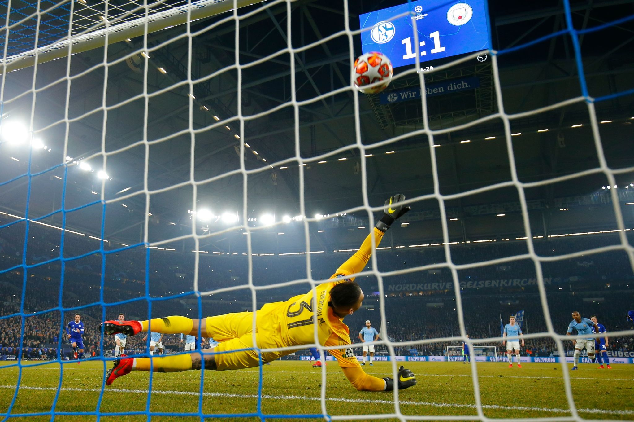 Manchester Citys Brazilian goalkeeper Ederson fails to stop a penalty kick from Schalkes Algerian midfielder Nabil <HIT>Bentaleb</HIT> during the UEFA Champions League round of 16 first leg football match between Schalke 04 and Manchester City on February 20, 2019 in Gelsenkirchen, Germany. (Photo by Odd ANDERSEN / AFP)