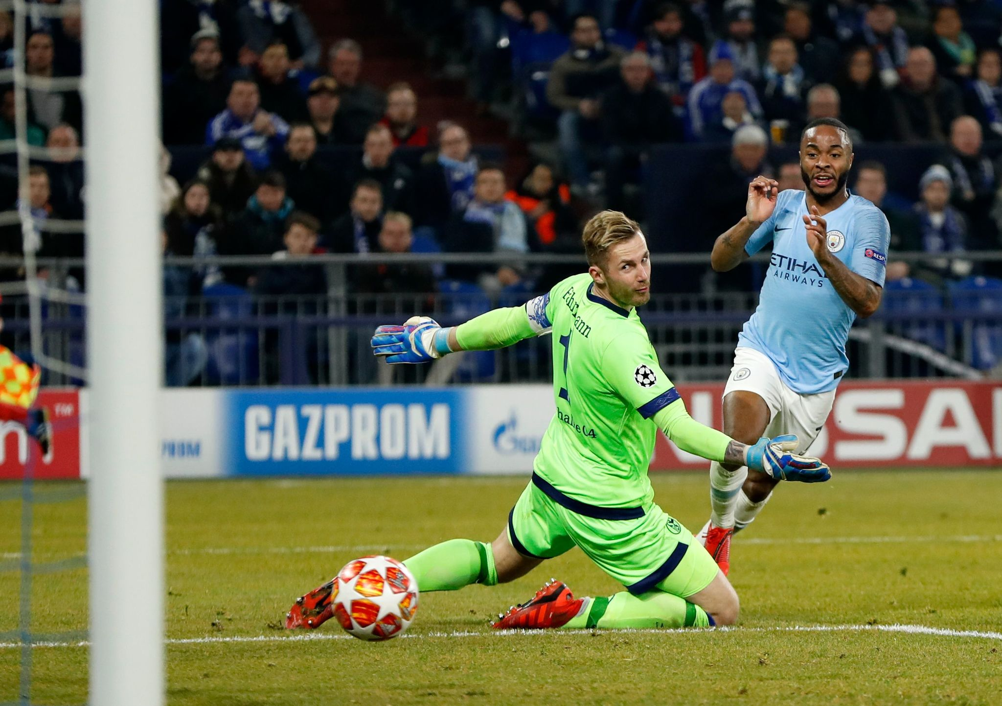 Manchester Citys English forward Raheem <HIT>Sterling</HIT> scores the winning 2-3 goal in front of Schalkes German goalkeeper Ralf Faehrmann during the UEFA Champions League round of 16 first leg football match between Schalke 04 and Manchester City on February 20, 2019 in Gelsenkirchen, Germany. (Photo by Odd ANDERSEN / AFP)