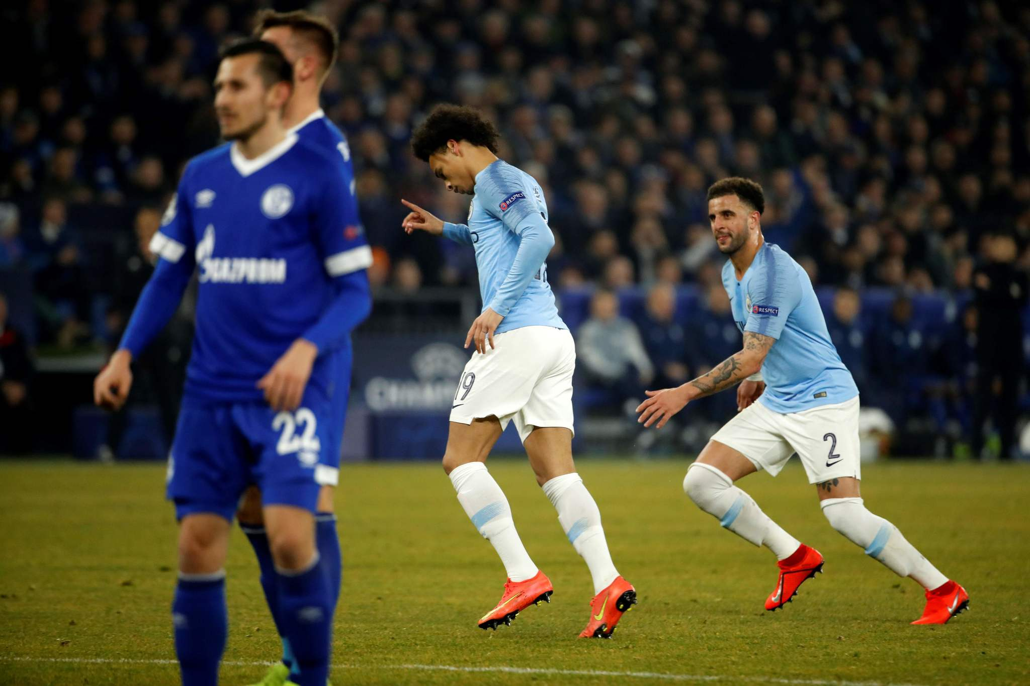Manchester Citys German midfielder Leroy <HIT>Sane</HIT> (C) celebrates after scoring a goal during the UEFA Champions League round of 16 first leg football match between Schalke 04 and Manchester City on February 20, 2019 in Gelsenkirchen, Germany. (Photo by Odd ANDERSEN / AFP)