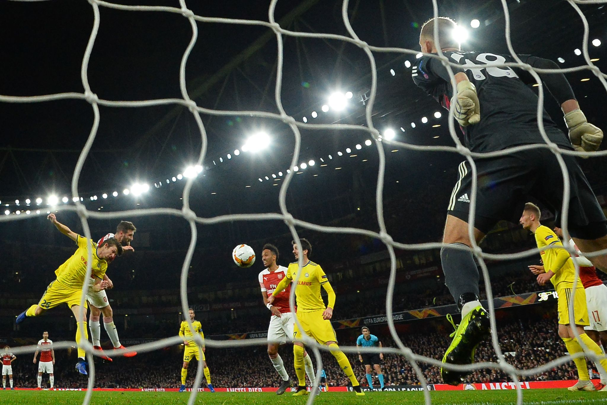 Arsenals German defender Shkodran <HIT>Mustafi</HIT> (2nd L) heads home their second goal during the UEFA Europa League round of 32, 2nd leg football match between Arsenal and Bate Borisov at the Emirates stadium in London on February 21, 2019. (Photo by Glyn KIRK / AFP)