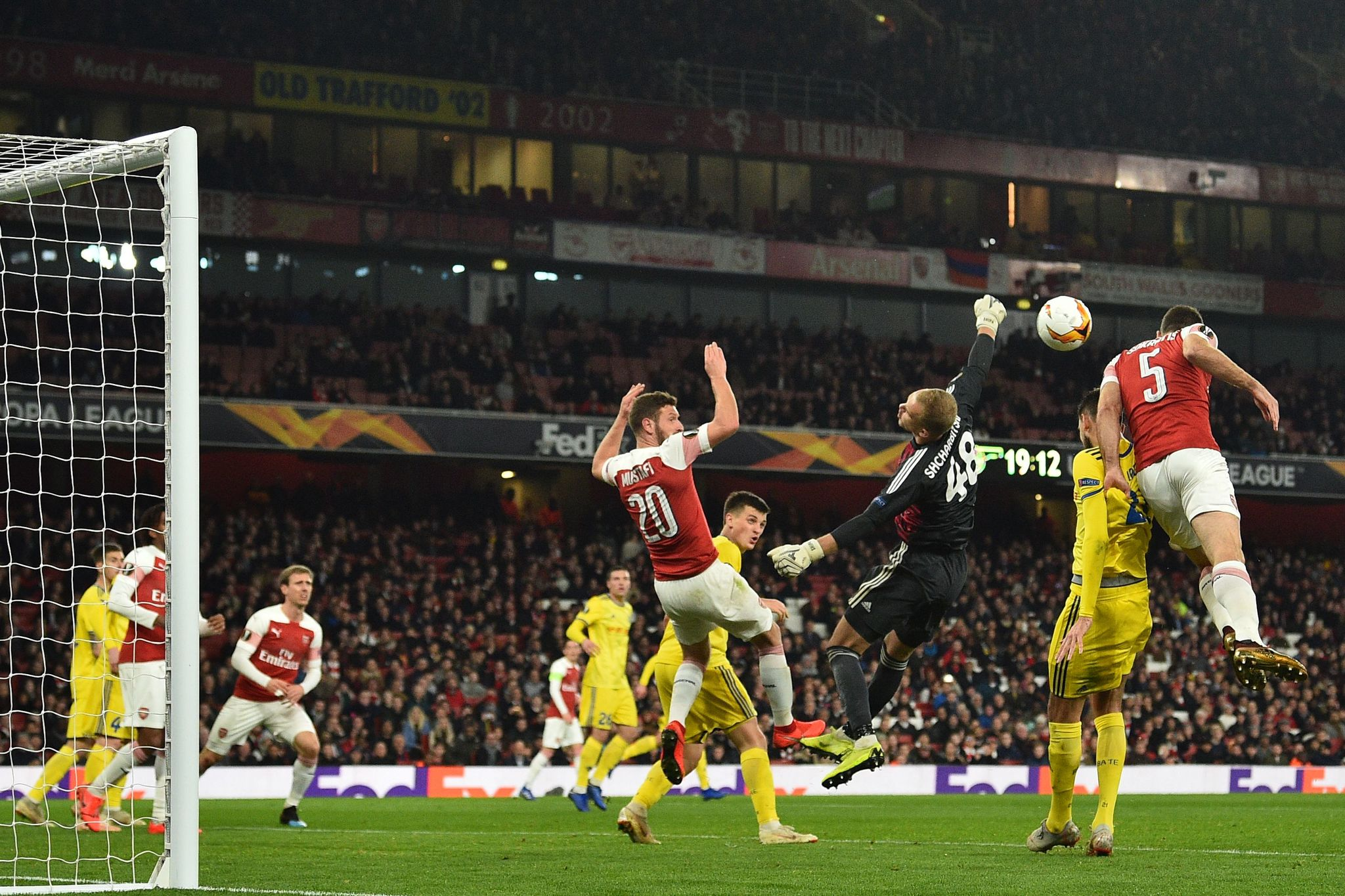 Arsenals Greek defender Sokratis Papastathopoulos (R) jumps to head home their third goal during the UEFA Europa League round of 32, 2nd leg football match between Arsenal and <HIT>Bate</HIT> Borisov at the Emirates stadium in London on February 21, 2019. (Photo by Glyn KIRK / AFP)