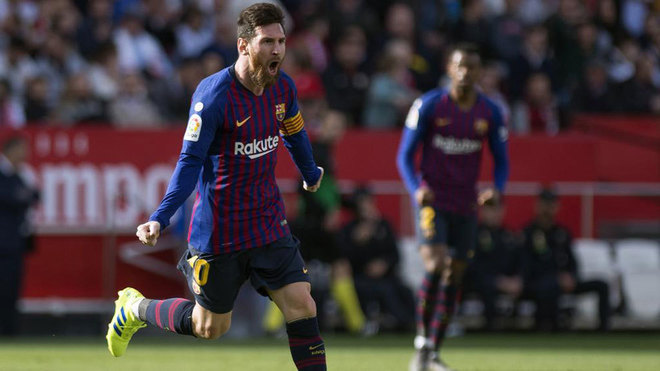 Lionel Messi celebrates after scoring a goal during the match between...
