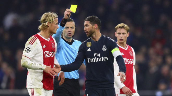 Sergio Ramos picking up a yellow card in Amsterdam.