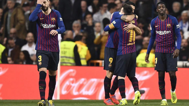 Luis Suarez celebrates his first goal with teammates