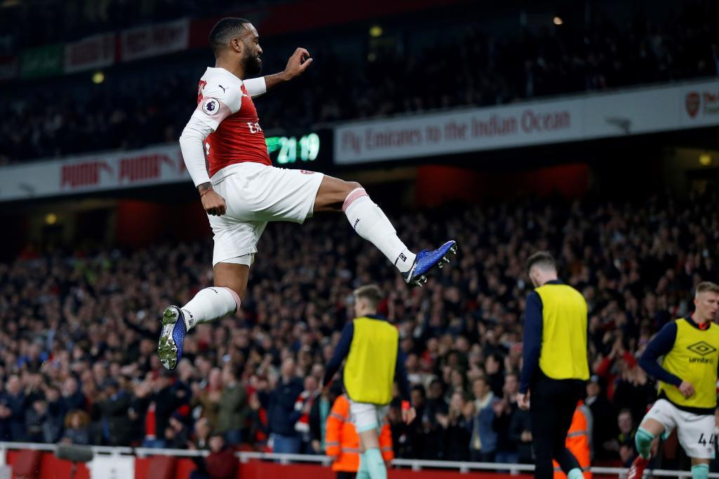 <HIT>Arsenal</HIT>s French striker Alexandre Lacazette celebrates scoring his teams fifth goal during the English Premier League football match between <HIT>Arsenal</HIT> and Bournemouth at the Emirates Stadium in London on February 27, 2019. (Photo by Ian KINGTON / AFP) / RESTRICTED TO EDITORIAL USE. No use with unauthorized audio, video, data, fixture lists, club/league logos or live services. Online in-match use limited to 120 images. An additional 40 images may be used in extra time. No video emulation. Social media in-match use limited to 120 images. An additional 40 images may be used in extra time. No use in betting publications, games or single club/league/player publications. /