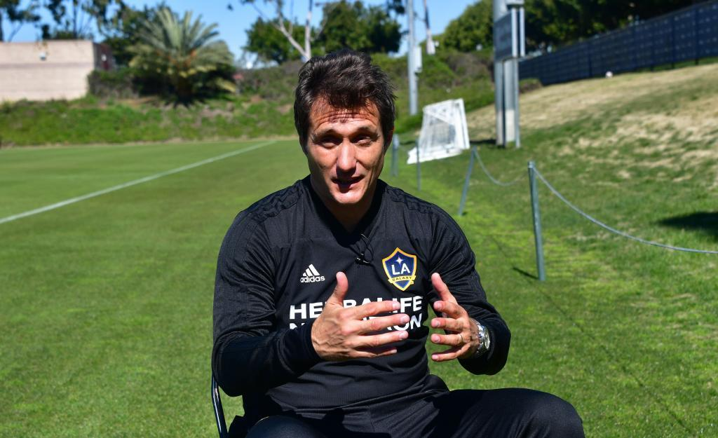 Guillermo Barros <HIT>Schelotto</HIT>, head coach of the LA Galaxy of the MLS, gestures while speaking during an interview with AFP on February 22, 2019 in Carson, California following a team training session. - From Buenos Aires to Los Angeles, without stops. From Boca to Galaxy, without safety net. Losing the final of the Libertadores against his archrival River to try to resurrect the most honored franchise in MLS history, Guillermo Barros <HIT>Schelotto</HIT> has never been afraid of the challenges. (Photo by Frederic J. BROWN / AFP)