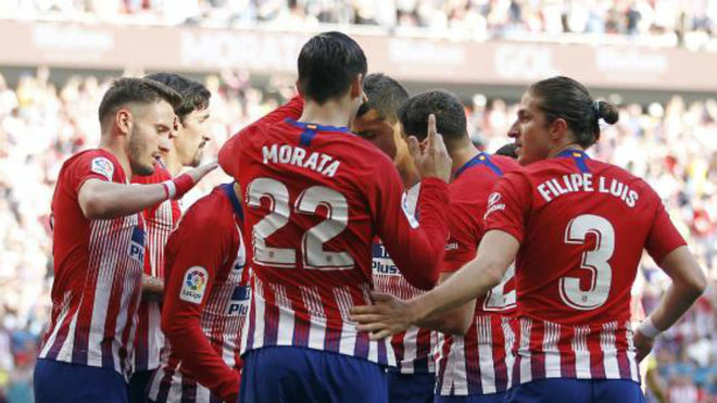 The Atletico players celebrate one of their goals against Villarreal