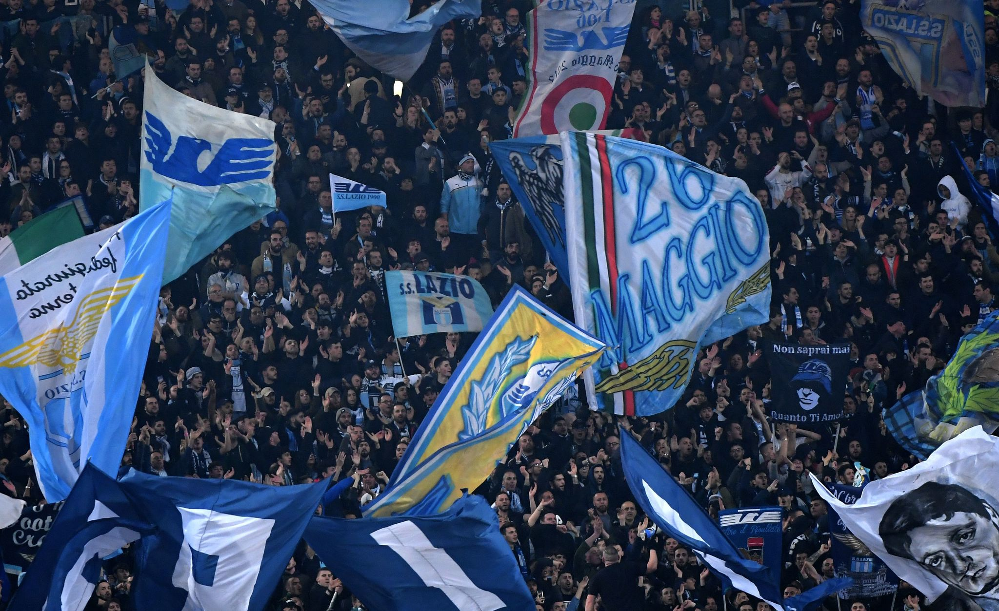 <HIT>Lazio</HIT>s supporters cheer during the Italian Serie A football match <HIT>Lazio</HIT> vs Roma on March 2 , 2019 at the Olympic stadium in Rome. (Photo by Tiziana FABI / AFP)