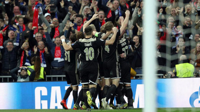Ajax players celebrate after Lasse Schone scored