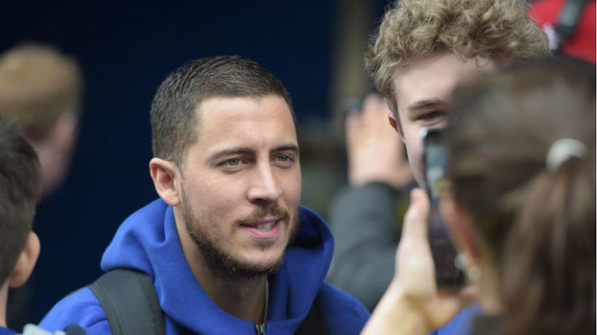 Eden Hazard alongside Chelsea supporters