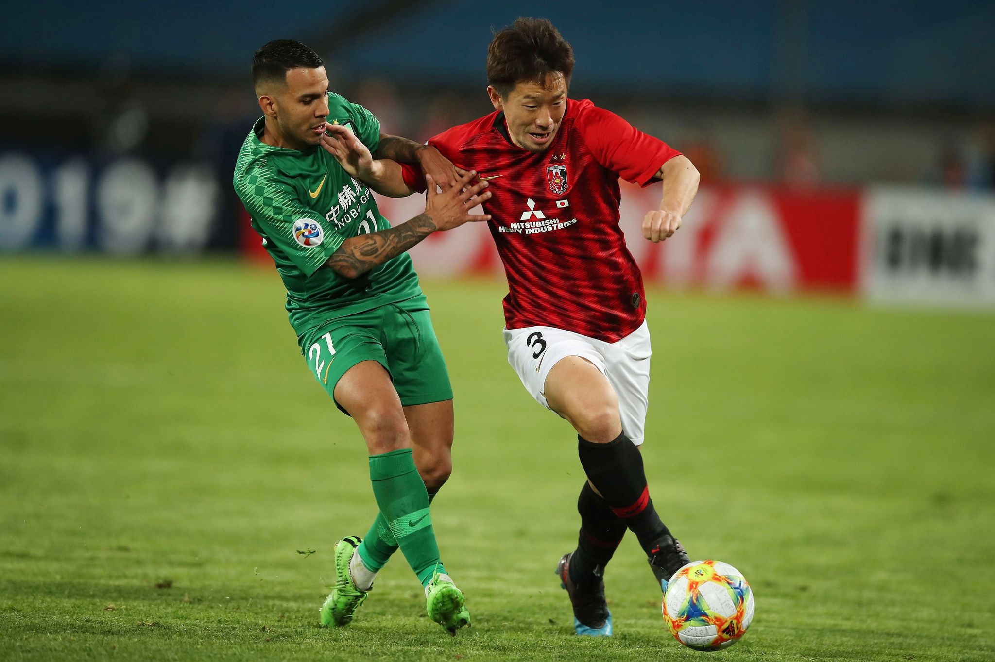 <HIT>Jonathan</HIT><HIT>Viera</HIT> (L) of Chinas Beijing Guoan fights for the ball with Tomoya Ugajin of Japans Urawa Red Diamonds during their AFC Champions League group stage football match in Beijing on March 13, 2019. (Photo by STR / AFP) / China OUT