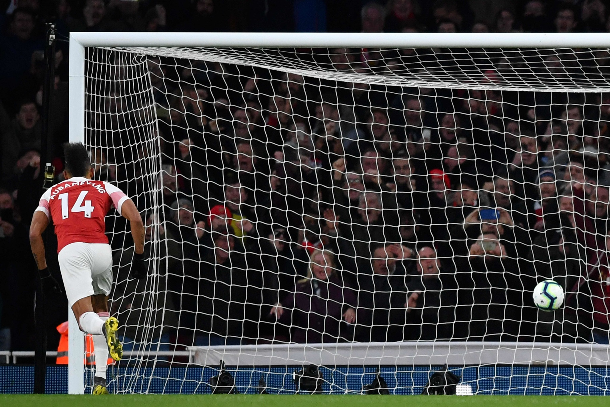 Arsenals Gabonese striker Pierre-Emerick <HIT>Aubameyang</HIT> (L) scores their second goal from the penalty spot during the English Premier League football match between Arsenal and Manchester United at the Emirates Stadium in London on March 10, 2019. (Photo by Ben STANSALL / AFP) / RESTRICTED TO EDITORIAL USE. No use with unauthorized audio, video, data, fixture lists, club/league logos or live services. Online in-match use limited to 120 images. An additional 40 images may be used in extra time. No video emulation. Social media in-match use limited to 120 images. An additional 40 images may be used in extra time. No use in betting publications, games or single club/league/player publications. /