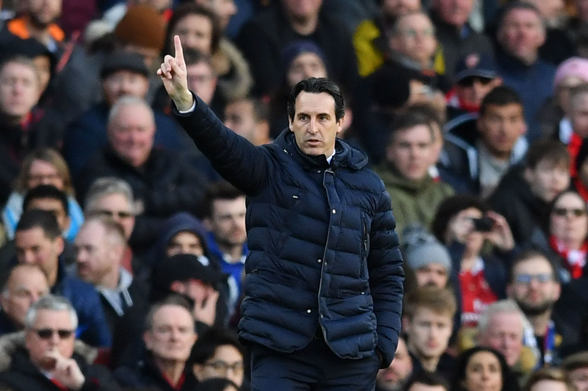 Arsenals Spanish head coach Unai <HIT>Emery</HIT> gestures from the touchline during the English Premier League football match between Arsenal and Manchester United at the Emirates Stadium in London on March 10, 2019. (Photo by Ben STANSALL / AFP) / RESTRICTED TO EDITORIAL USE. No use with unauthorized audio, video, data, fixture lists, club/league logos or live services. Online in-match use limited to 120 images. An additional 40 images may be used in extra time. No video emulation. Social media in-match use limited to 120 images. An additional 40 images may be used in extra time. No use in betting publications, games or single club/league/player publications. /