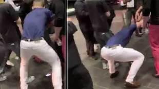 Conor McGregor robándole el móvil al aficionado Ahmed Abdirzak en el...