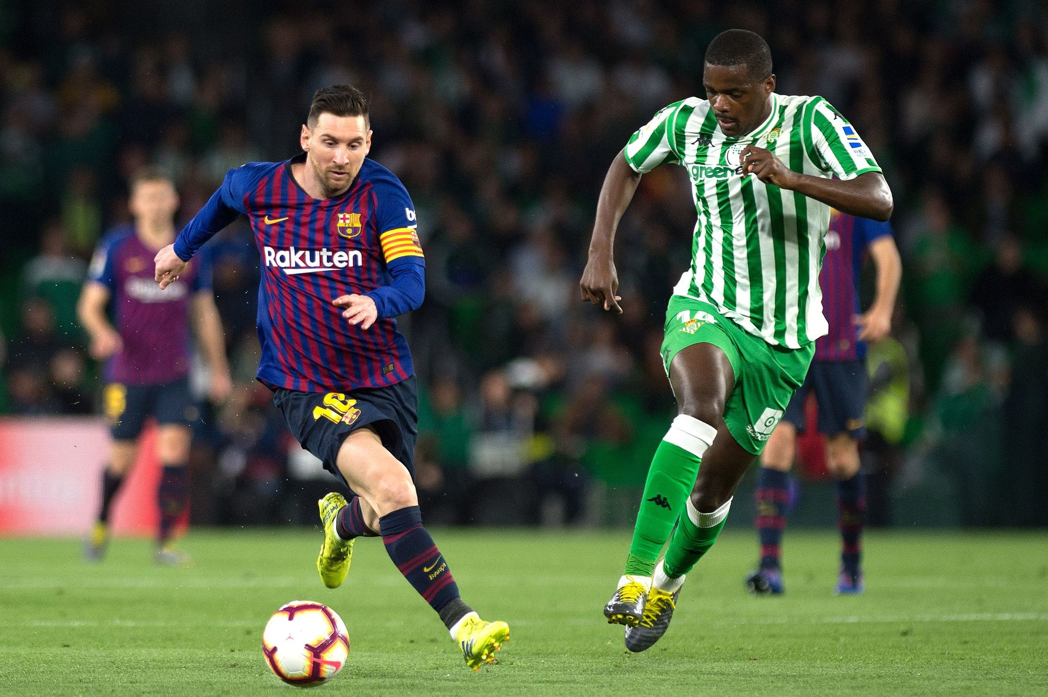 Barcelonas Argentinian forward Lionel Messi (L) vies with Real <HIT>Betis</HIT> Portuguese midfielder <HIT>William</HIT> Carvalho during the Spanish league football match between Real <HIT>Betis</HIT> and FC Barcelona at the Benito Villamarin stadium in Seville on March 17, 2019. (Photo by JORGE GUERRERO / AFP)