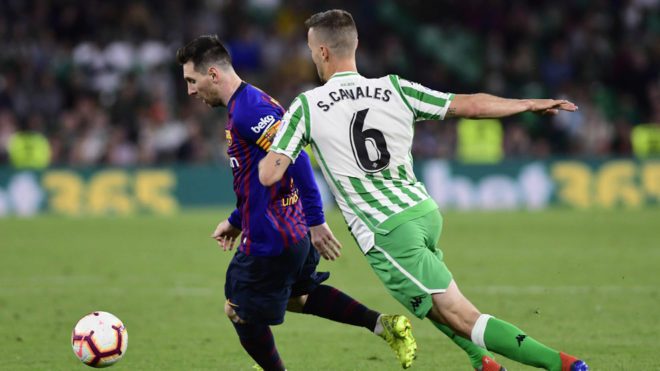 Lionel Messi and Sergio Canales during the Betis-Barcelona match last...