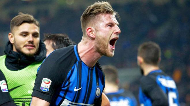 Milan Skriniar celebrates winning the Milan derby.