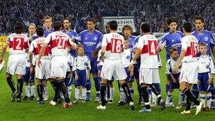 Los jugadores del Sevilla y el Schalke, Puerta incluico (número 27),...