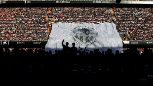 Spectacular backlit image of the Valencia players with supporters sat...