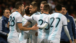 The Argentine players celebrate their goal.