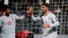 Morata celebra con Asensio uno de sus goles.