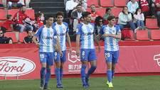Ricca, Blanco Leschu, Adrián y Mula celebran el gol del Málaga en...